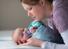 Mother and baby. Mother holding baby interacting close up royalty free stock photography