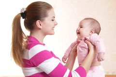 Mother and baby at home Stock Images