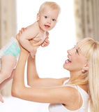 Mother with baby at home Stock Images
