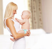 Mother with baby at home Stock Image