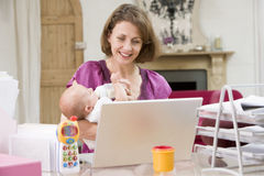 Mother and baby in home office stock photography