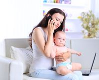 Mother and baby in home office Stock Images