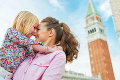 Mother and baby hugging in venice, italy stock images