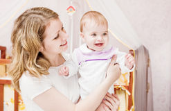 Mother with baby indoor Royalty Free Stock Images