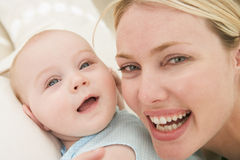 Mother and baby indoors Stock Photos