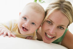 Mother and baby indoors smiling stock photography