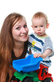 Mother with baby isolated. Mother with the child and with toy car Royalty Free Stock Images