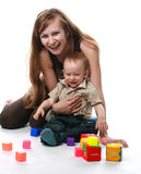 Mother with baby isolated. Mother with the child is played with cubes Royalty Free Stock Images