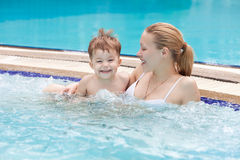 Mother and baby in a jacuzzi Stock Photo