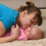 Mother and Baby kissing and hugging Royalty Free Stock Image
