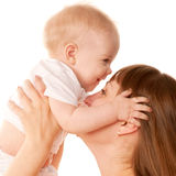 Mother and baby kissing. Motherhood concept. Royalty Free Stock Photos