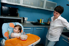 Mother and baby at the kitchen Stock Images