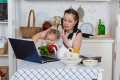 Mother with baby in kitchen. Stock Photo