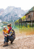 Mother and baby on lake braies in south tyrol Stock Photo