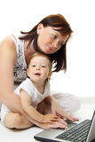 Mother and baby with laptop Stock Photos