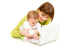 Mother and baby at laptop Royalty Free Stock Photos