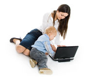 Mother and baby with laptop Royalty Free Stock Photography