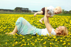Mother and Baby Laughing in Dandelions royalty free stock photos
