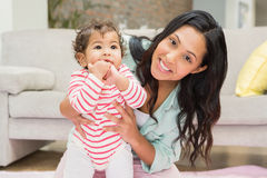 Mother with baby learning to walk Royalty Free Stock Images
