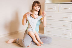 Mother and baby legs. First steps. Royalty Free Stock Images
