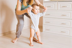 Mother and baby legs. First steps. Royalty Free Stock Image