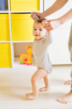 Mother and baby legs. First steps. Stock Photos