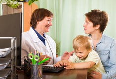 Mother with baby listening friendly pediatrician doctor Royalty Free Stock Images