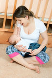 Mother and baby in living room Royalty Free Stock Photos