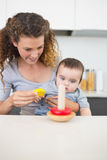 Mother with baby looking at toys Royalty Free Stock Photo