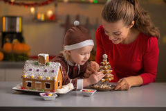 Mother and baby making christmas cookie house Stock Photography