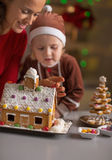 Mother and baby making christmas cookie house Royalty Free Stock Photos