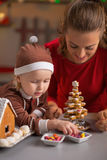 Mother and baby making cookie christmas tree Royalty Free Stock Photo