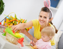 Mother and baby making easter decoration Royalty Free Stock Images