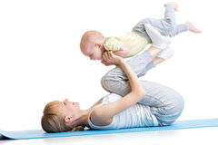Mother and baby making fitness exercises Stock Image