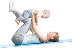 Mother and baby making gymnastics Stock Photo
