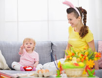 Mother and baby making preparations for Easter Royalty Free Stock Images