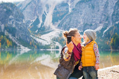 Mother and baby making selfie on lake braies Stock Photo