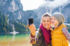 Mother and baby making selfie on lake braies Royalty Free Stock Photography