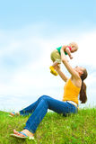 Mother with  baby  on the meadow Royalty Free Stock Image