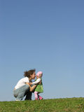 Mother with baby on meadow stock photos