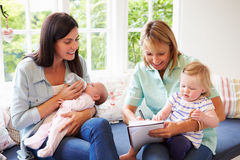 Mother With Baby Meeting With Health Visitor At Home Royalty Free Stock Image