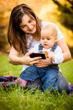 Mother and baby - modern world Royalty Free Stock Photos