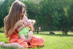 Mother and baby on natural background Stock Photos