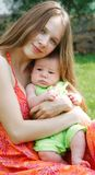 Mother and baby on natural background Stock Photography