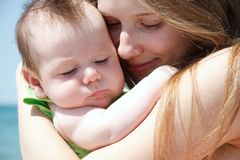Mother and baby on nature Stock Photo