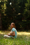 Mother with baby in nature. Young mother relax in nature with sleeping baby Royalty Free Stock Photography