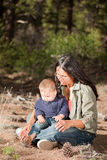 Mother and baby in nature. Native American mother and her mixed race baby boy enjoying a day in the nature. Shallow DOF, focus on woman's face Stock Images