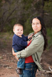Mother and baby in nature. Native American mother and her mixed race baby boy enjoying a day in the nature Stock Image