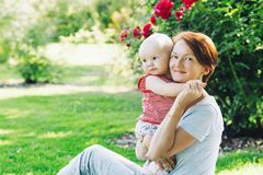 Mother and baby in nature royalty free stock images