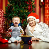 Mother and Baby Near Christmas Three Royalty Free Stock Images